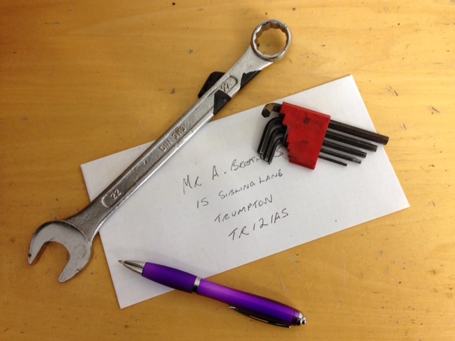 Envelope-with-pen-spanner-tools-photo